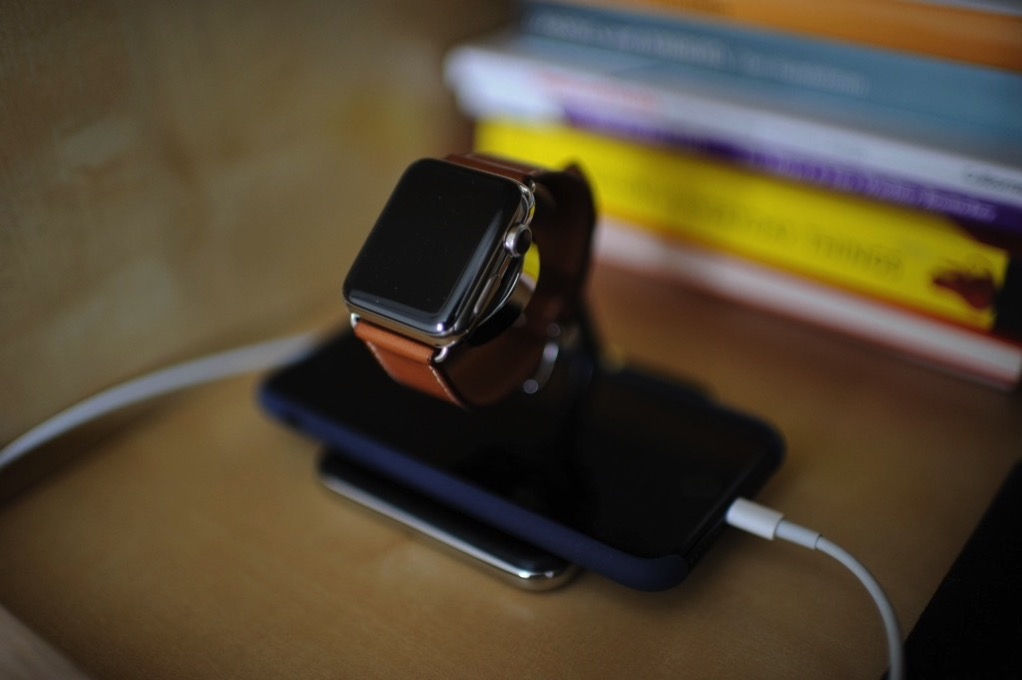 My Apple Watch and iPhone 7 on my bedside stand