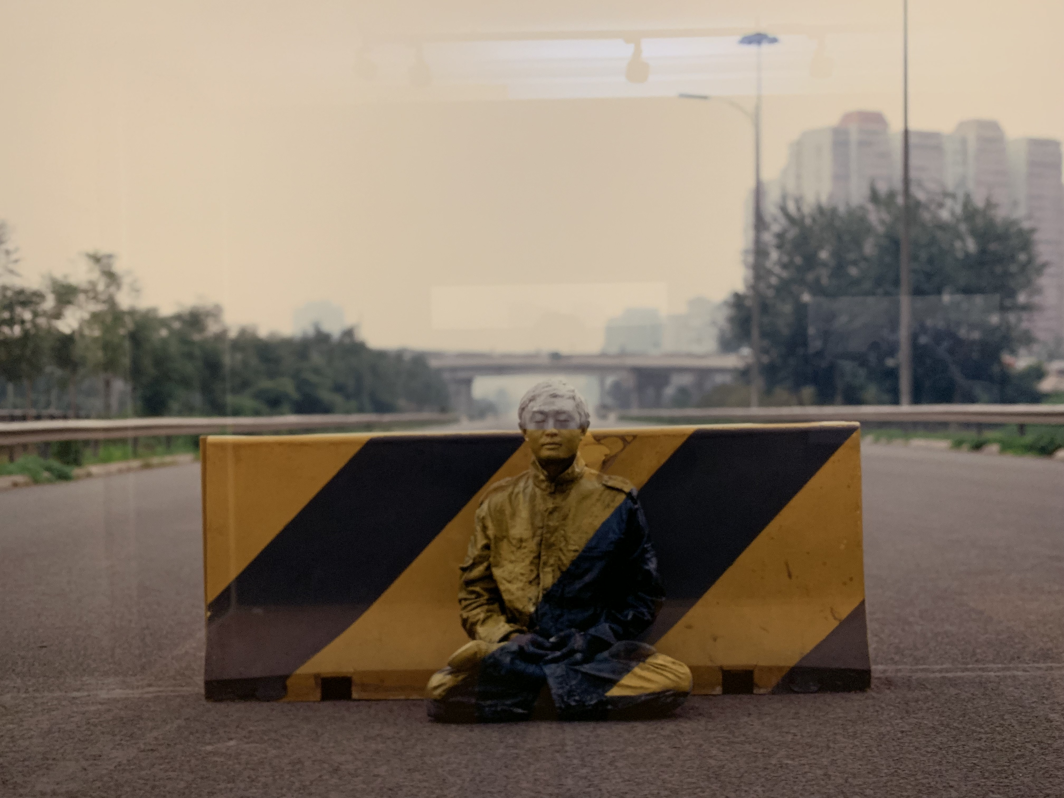 Liu Bolin painted into a road block
