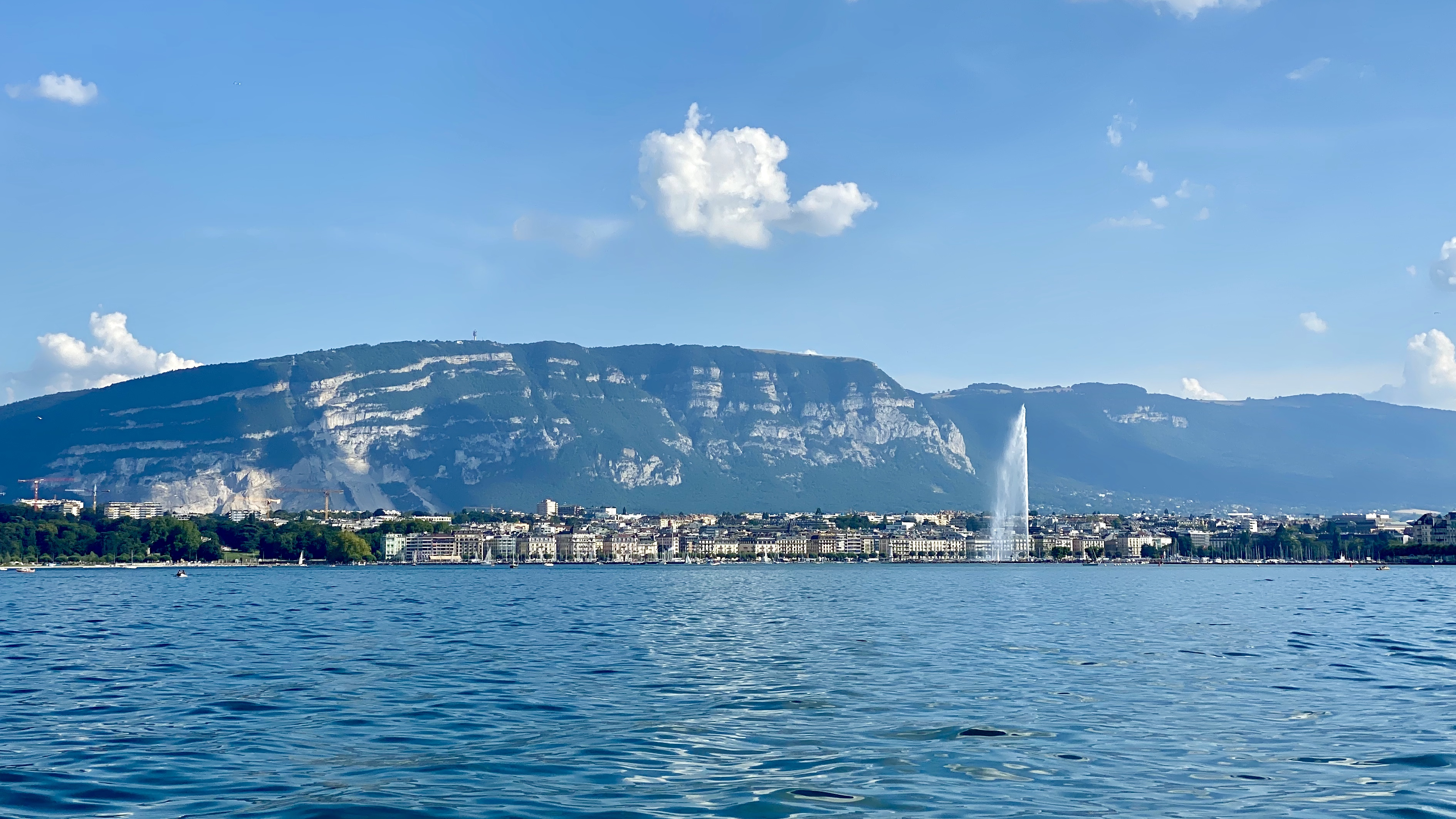Geneva viewed froim the lake with the Salève in the background and the Jet d'Eau