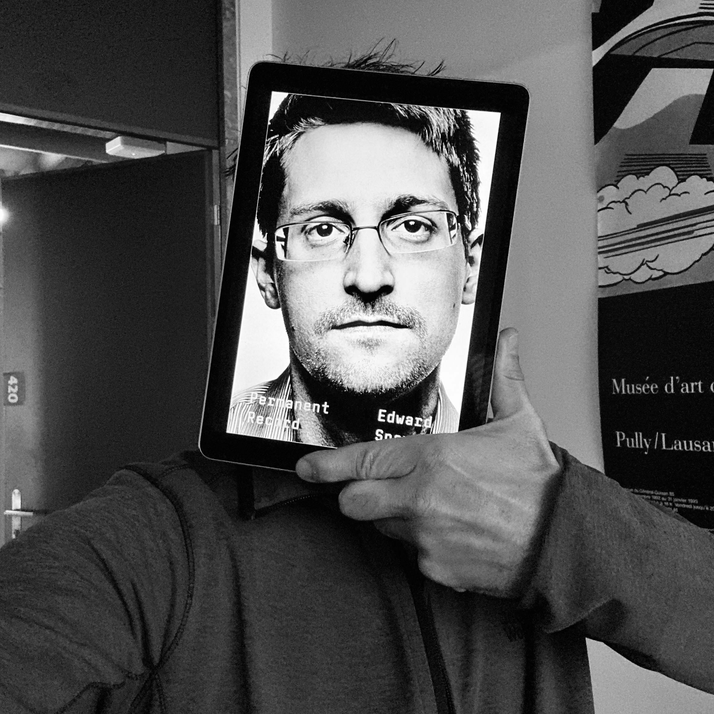 Self portrait with the portrait of Edward Snowden covering my face
